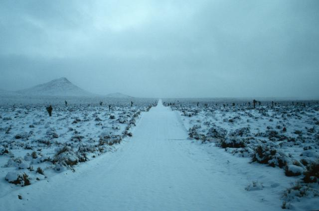 Image of a snow covered road in the desert.